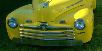 1946 Ford headlights, hood ornament, and grill
