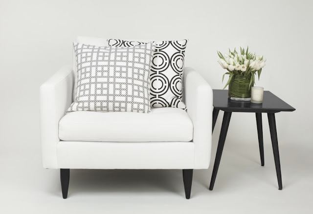 COCOCOZY Light pillows on a white armchair