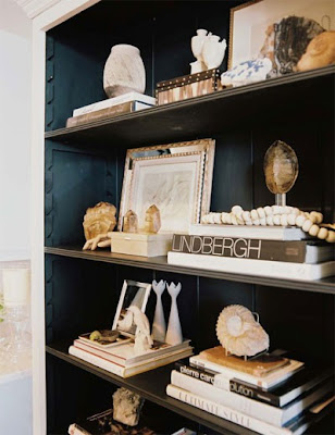 dark shelving with white accessories