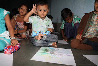 A young aspiring painter at Aarambh calling out to volunteers!