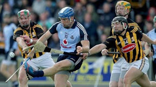 Kieran Joyce and Richie Hogan of Kilkenny attempt to tackle Dublin's Conal Keaney during the replay on Saturday night.