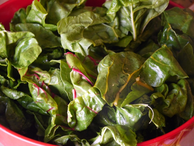 Meanwhile tear the leaves of of the chard from the stems and rinse ...