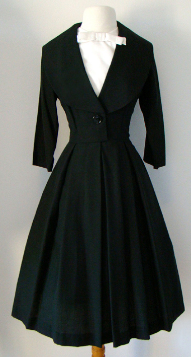 1940s dress that looks like a cross between a man's suit and a normal vintage dress