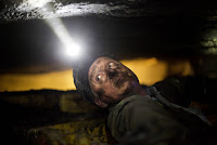 Coal miner uderground (Credit: AP Photo/David Goldman) Click to Enlarge.