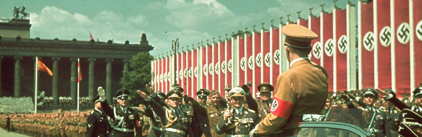 hitler on horseback being saluted by followers, nazi flags fluttering