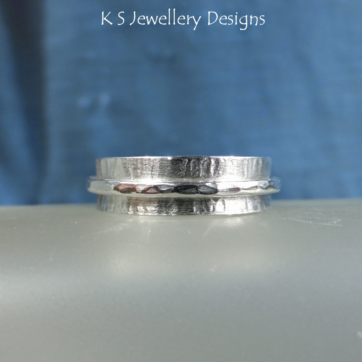 http://ksjewellerydesigns.co.uk/ourshop/prod_3130563-Sterling-Silver-Spinner-Ring-Bark-Texture-MADE-TO-ORDER.html