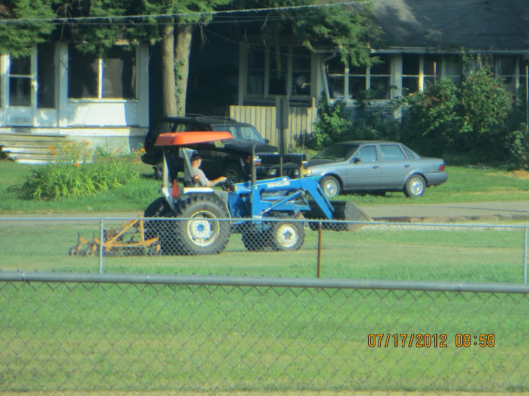 A NO job application BLV employee re-mowing the BLV ballfield.