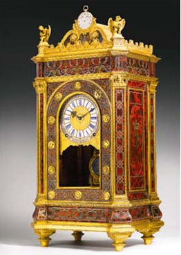 red and gold antique sympathique clock by breguet