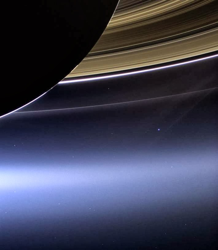 A small bright spot on the right - photographed by an automatic interplanetary station Cassini planet Earth, at a distance of billions of kilometers from Saturn's rings.