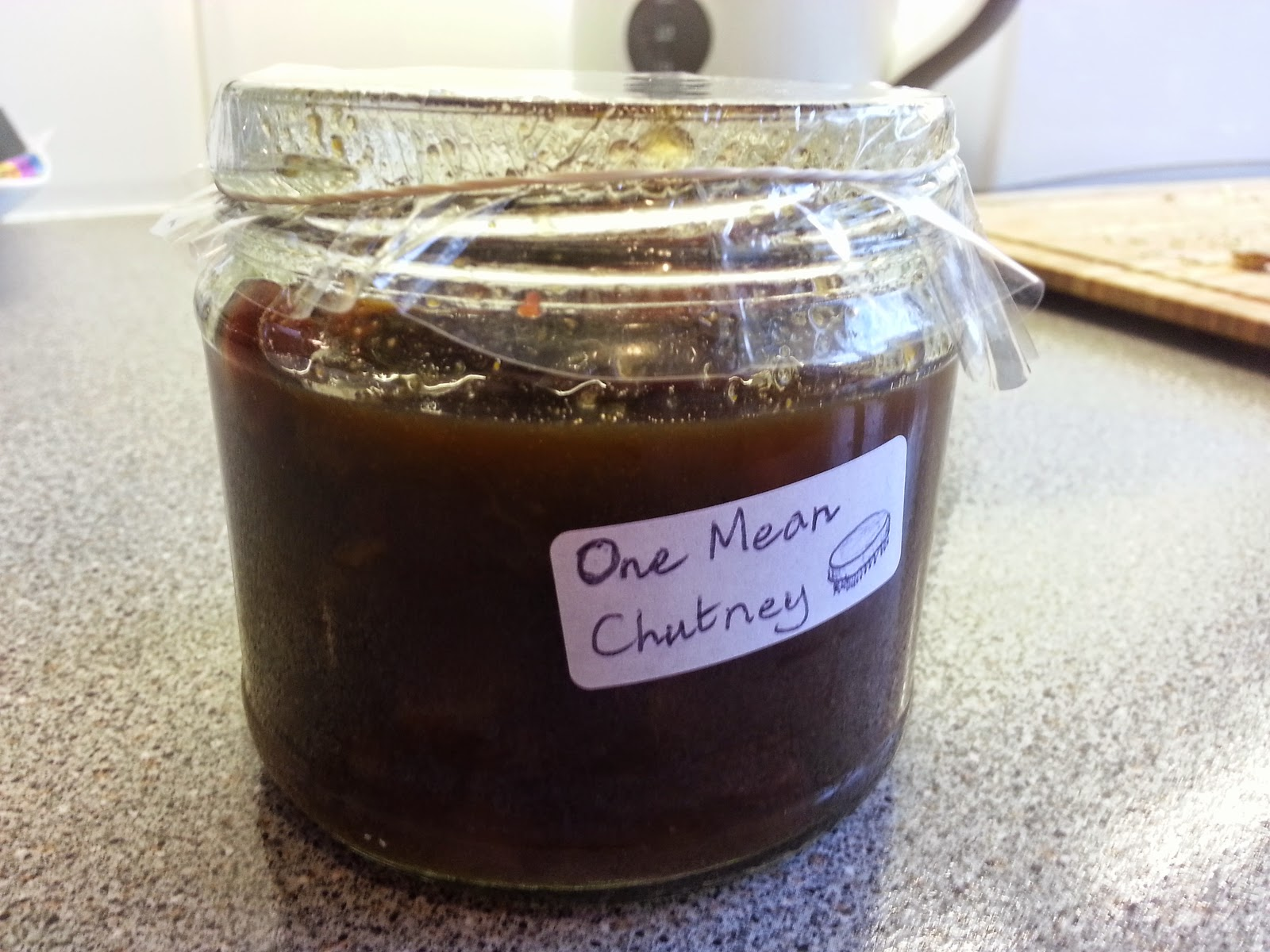 Homemade Indian Apple Chutney in a jar with handwritten label