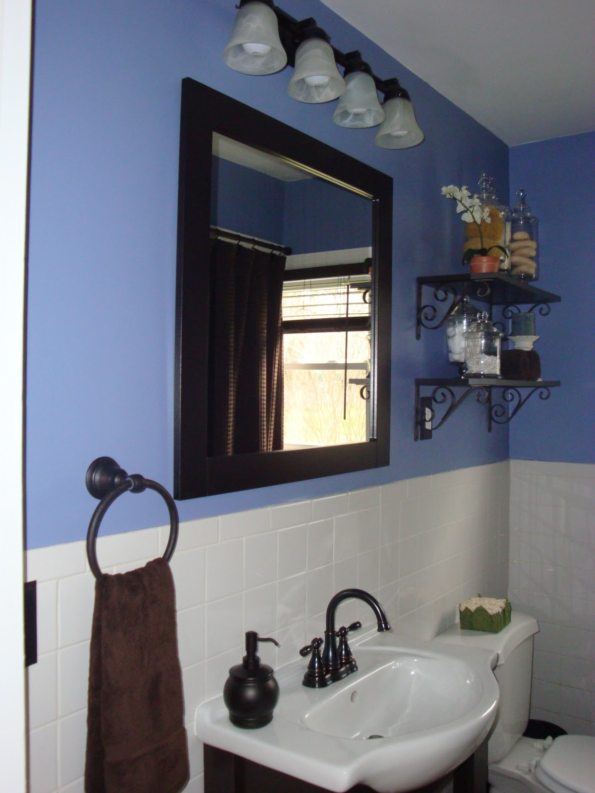 Ashley 39 s nest inexpensive bathroom remodel for Blue and black bathroom ideas