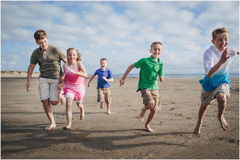Children racing across the sand