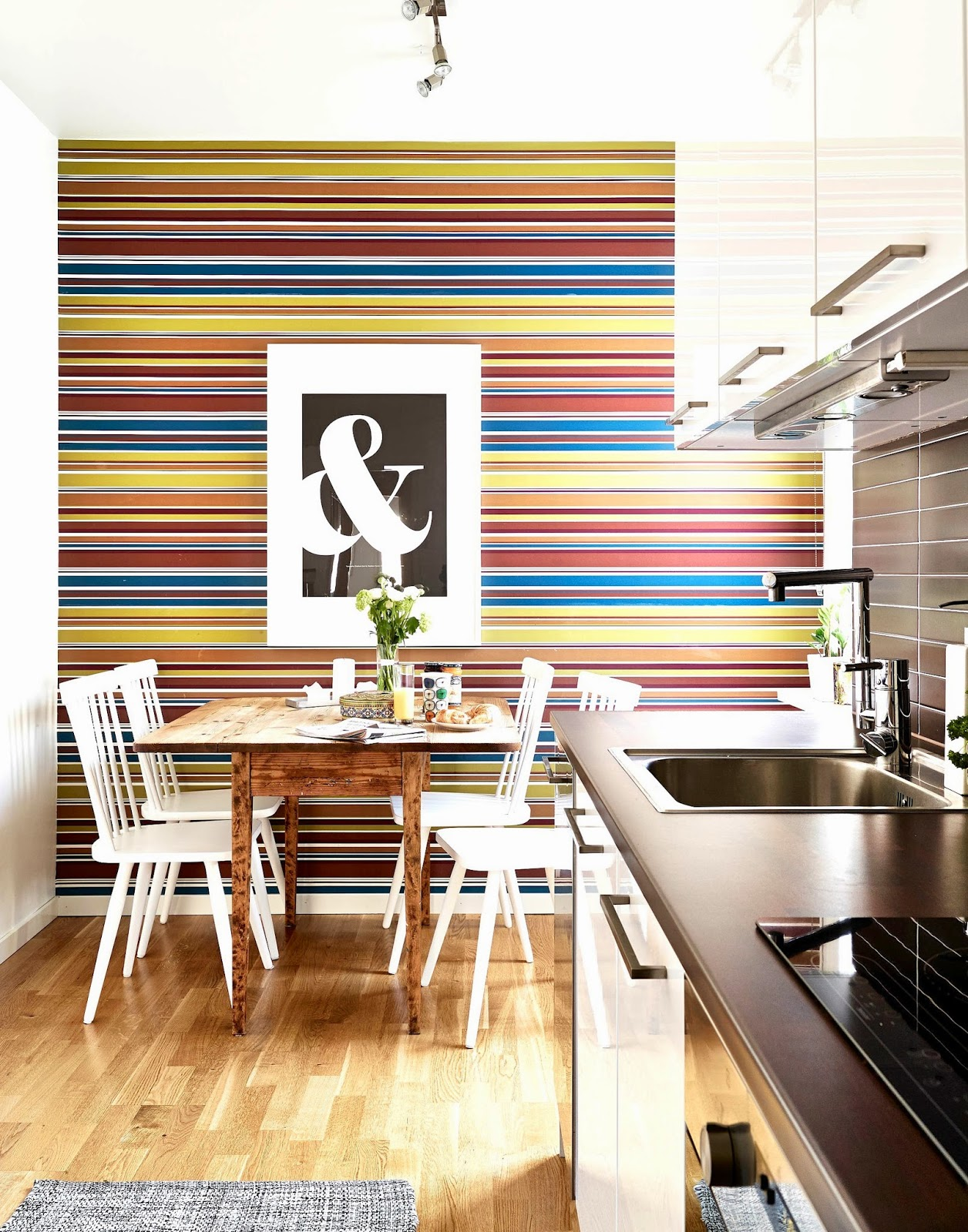 Small kitchen with bold striped feature wall