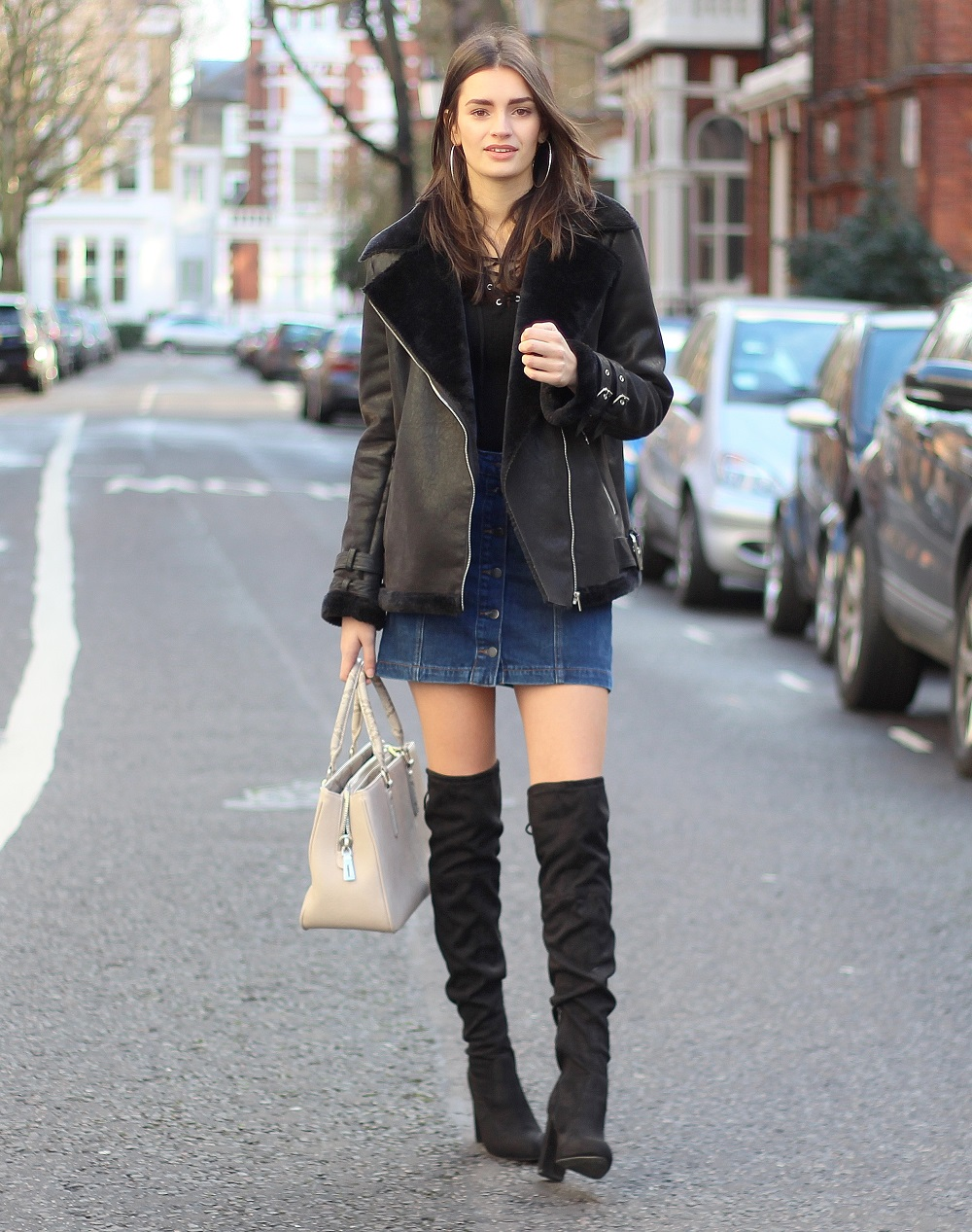 peexo fashion blogger wearing aviator jacket and knee high boots