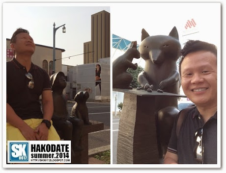 Hakodate Japan - Posing with Statues on the Street