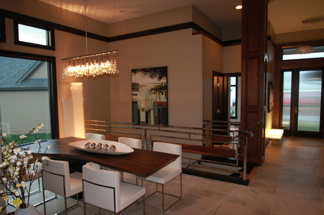 Modern Dining Room with Dining Room Tables And Chairs in White under the Bright Track Lamps