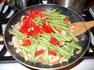 Adding in red pepper and green beans