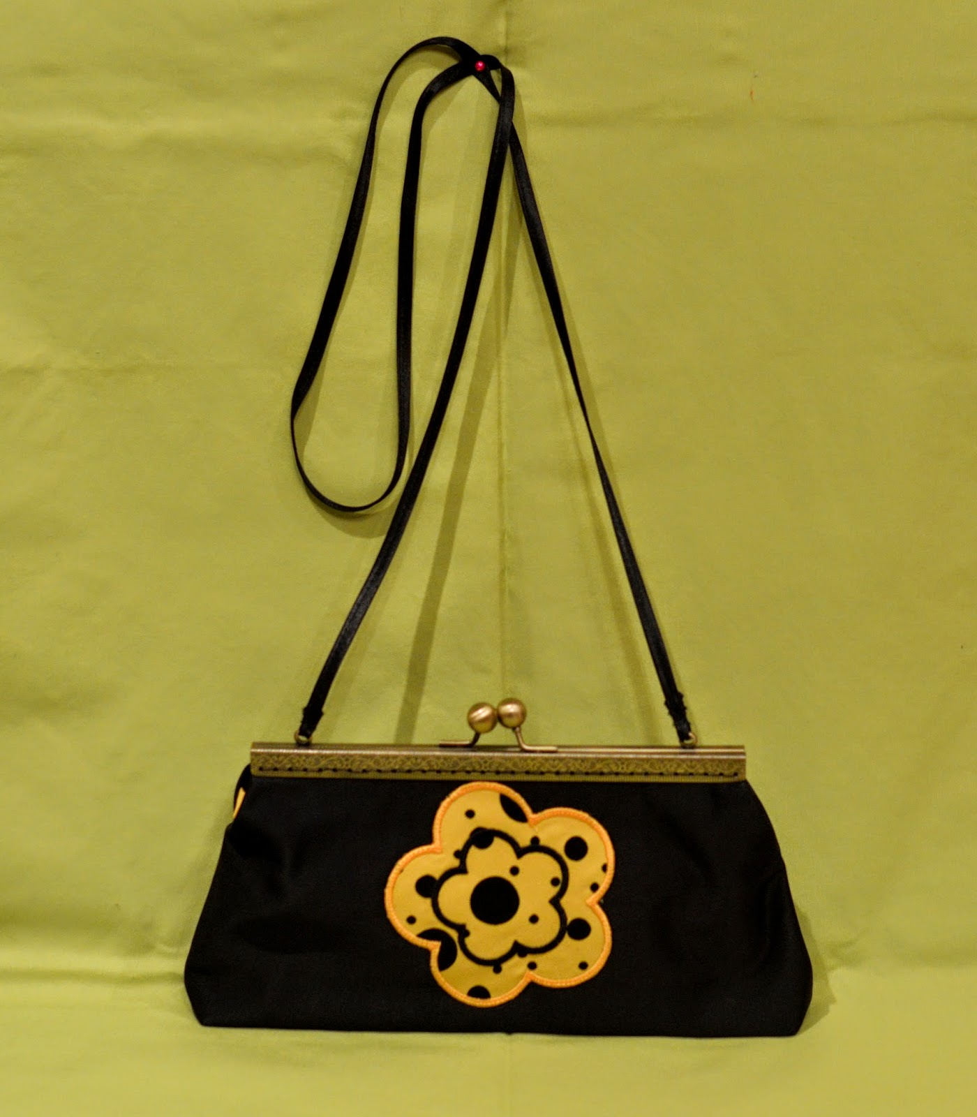 clutch bag with embroidered flower embellishment