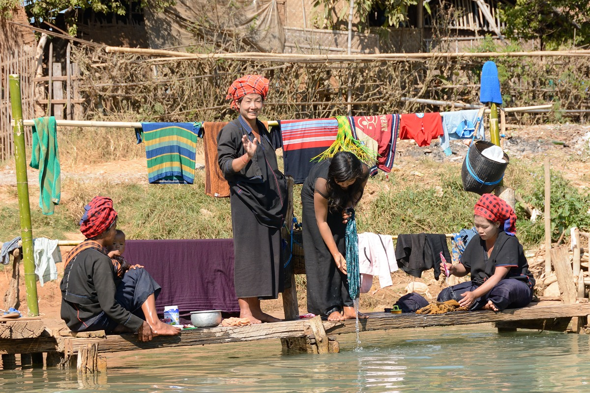 Women washing clothes on the Indein River in Myanmar