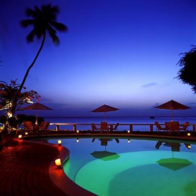 Playa y piscina en el hotel Cobblers Cove en Barbados.