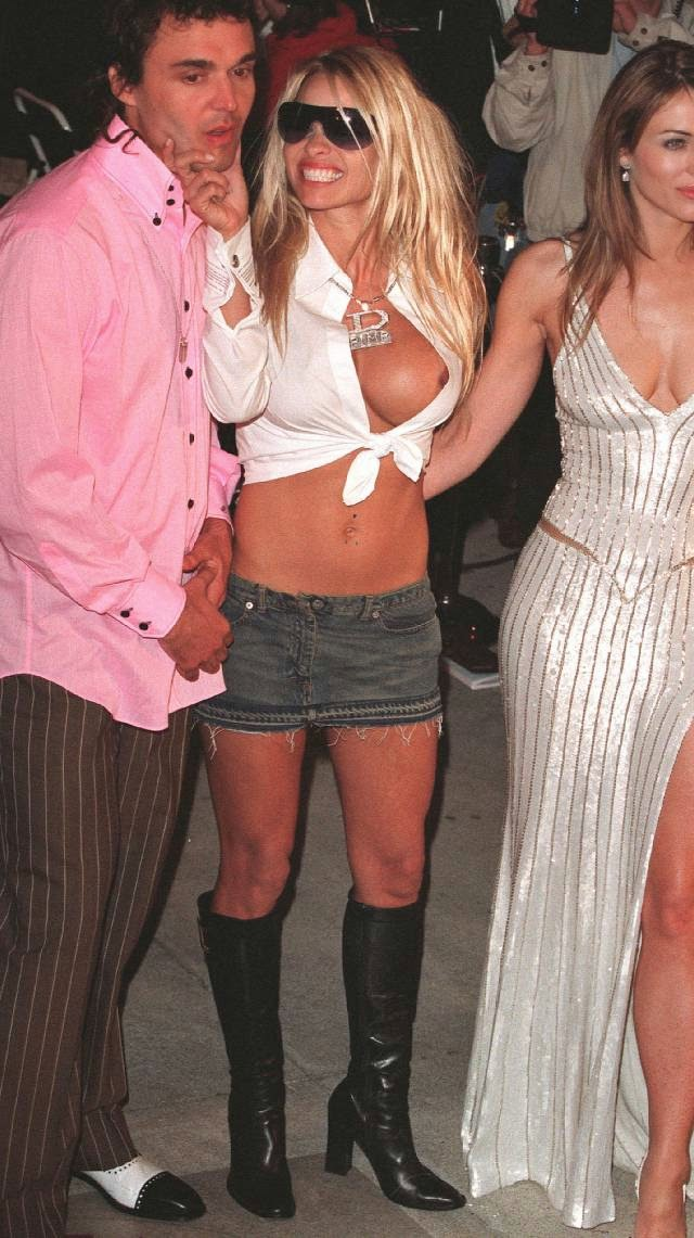 Pamela Andersons tits flashing at the Oscar Vanity Fair after party 2001