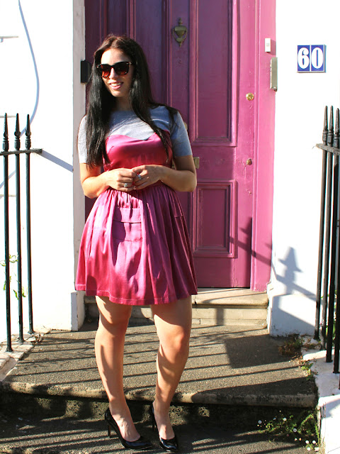 London fashion blogger Emma Louise Layla in pink satin dress in Camden