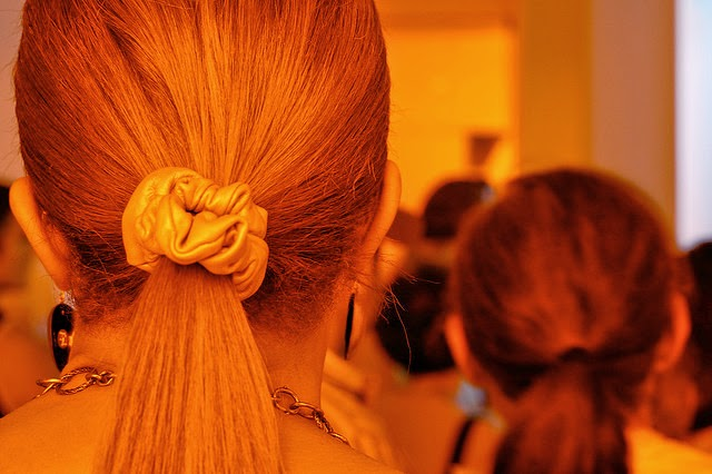 Women wearing scrunchies and visible hair bands.