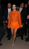 Eva Longoria leggy in bright orange outfit