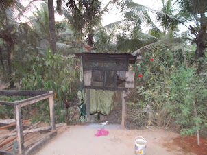 Typical village house  chicken roosting cage.