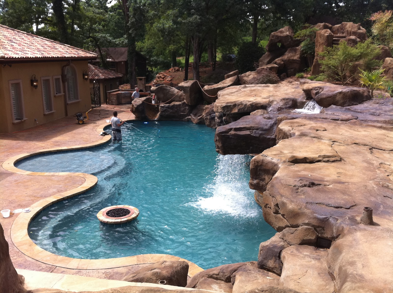 1000 images about swimming pool waterfall slides on for Rock pool designs