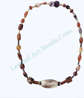 This small necklace consists of colored beads and is typical of the type generally given to the deceased.