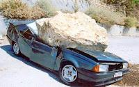 Carro Amassado por Pedra.