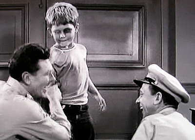 Opie shows his black eye to father Andy and Barney in Andy Griffith TV show 1961