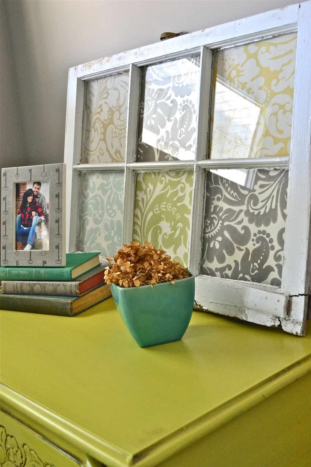 Scrapbook paper in window for decor