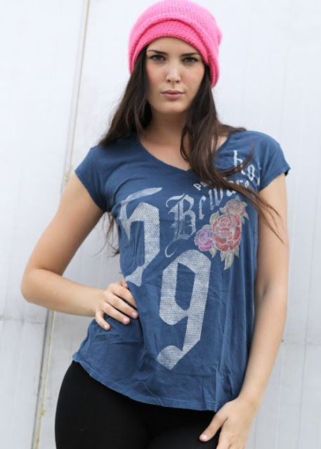 Red woolen hat, t shirt and black pants for ladies