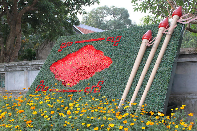 Dozens of flowers are used to decorate the logo of Temple of Literature in Hanoi, Vietnam