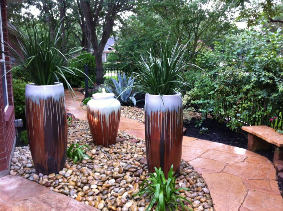 Laird landscaping inc adding beautiful potted plants to for Beautiful planters