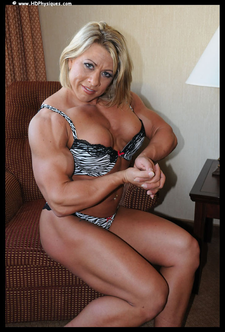 Julie Bourassa Flexing Her Biceps And Chest