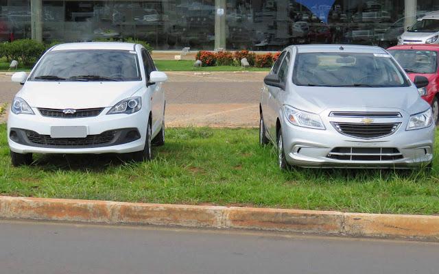 Chevrolet Onix 2016 1.0 Prata x Chery Celer 1.5 Flex
