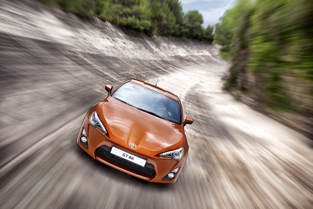 Toyota GT 86 on the road orange