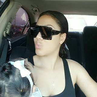 Photos: Nadia Buari poses with one of her twin girls