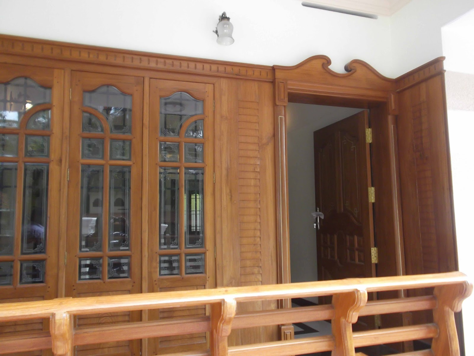 Kerala style carpenter works and designs front entrance for Wood doors and windows
