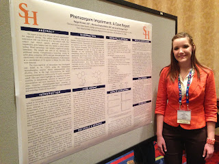 Paige Hinners poses with her research on an impaired driving case.