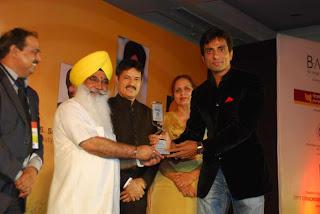 S Sewa Singh  Sekhnwan awarding Sonu Sood