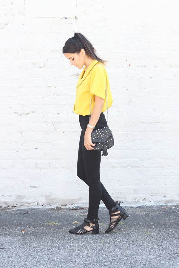vintage yellow cropped collared shirt black high waisted jeans leather sandals studded bag