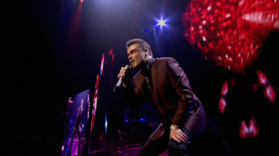 George Michael singing, heart background. London, 2008.