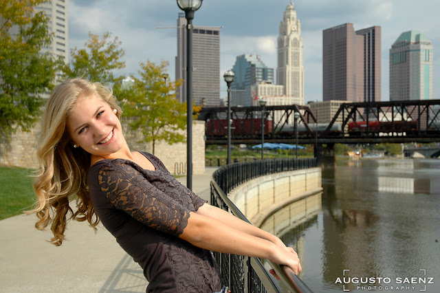 Senior Picture of Olivia holding rail By Scioto River Columbus, OH