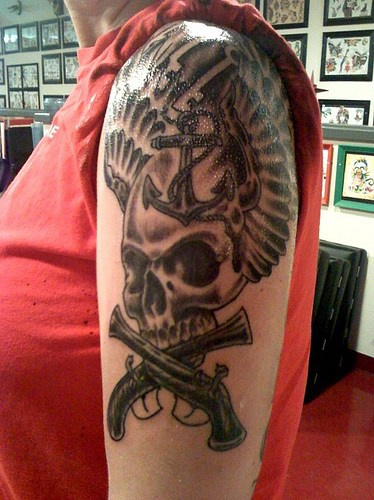 Muskets anchor and skull with wings on shoulder