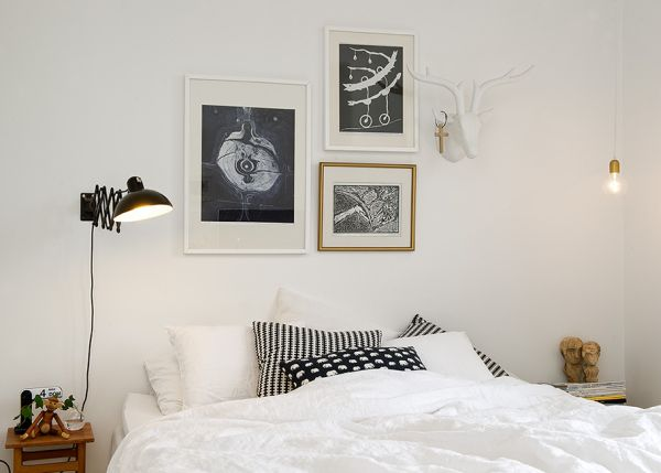 http://www.homedit.com/35-scandinavian-bedroom-ideas-that-looks-beautiful-modern/white-bedroom-black-head-lamp/