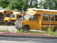 yellow school bus with hood open